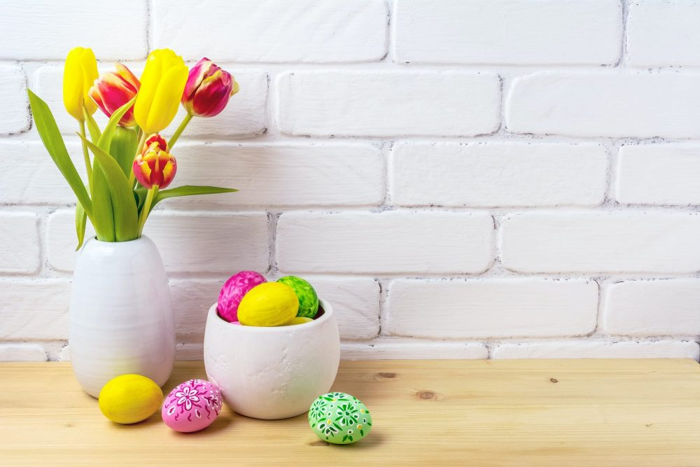 Easter rustic arrangement with eggs, red and yellow tulips